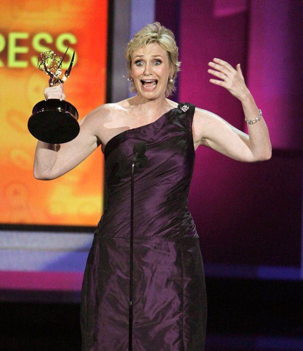 "Jane Lynch accepts the award for outstanding supporting actress in a comedy series for her work in ""Glee"" during the 62nd Primetime Emmy Awards Sunday, Aug. 29, 2010, in Los Angeles. (AP Photo/Chris Carlson)"