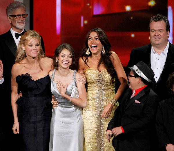 "The cast of ""Modern Family"" react as they accepts the award for outstanding comedy series during the 62nd Primetime Emmy Awards Sunday, Aug. 29, 2010, in Los Angeles. From left are presenter Ted Danson, Julie Bowen, Sarah Hyland, Sofia Vergara, Rico Rodriguez and Eric Stonestreet. (AP Photo/Chris Carlson)"