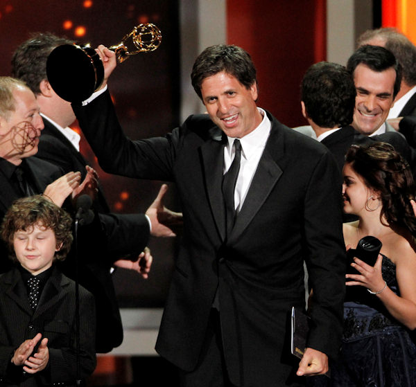 "Steven Levitan accepts the award for outstanding comedy series for ""Modern Family"" during the 62nd Primetime Emmy Awards Sunday, Aug. 29, 2010, in Los Angeles. At bottom left is cast member Nolan Gould. (AP Photo/Chris Carlson)"