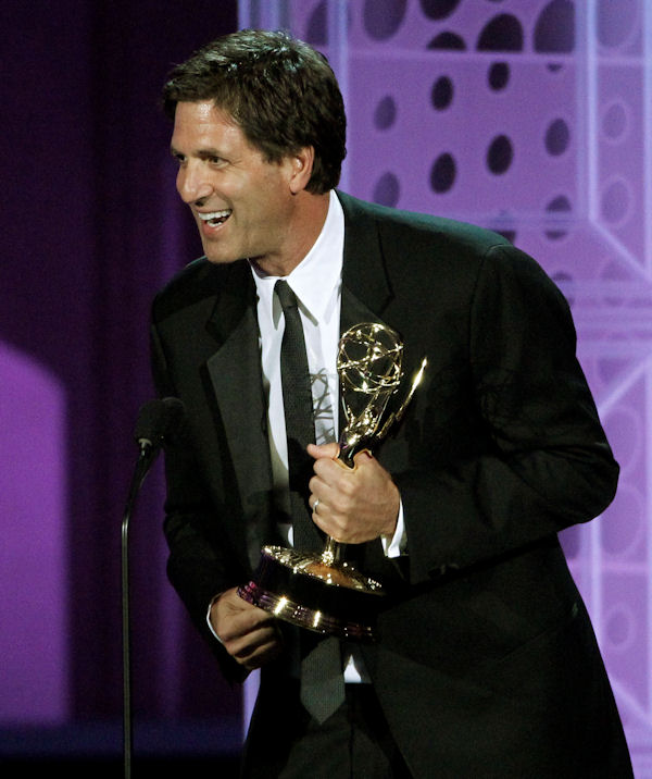 "Steven Levitan accepts the award for outstanding writing for a comedy series for ""Modern Family"" during the 62nd Primetime Emmy Awards Sunday, Aug. 29, 2010, in Los Angeles. (AP Photo/Chris Carlson)"