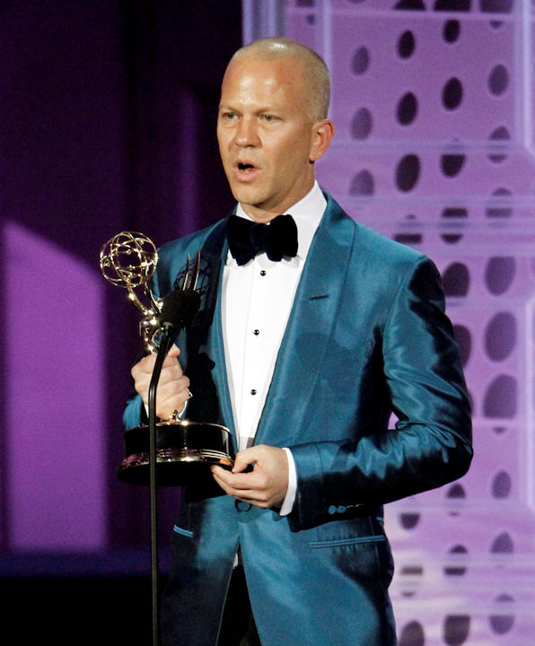"Ryan Murphy accepts accepts the award for outstanding directing for a comedy series for ""Glee"" during the 62nd Primetime Emmy Awards Sunday, Aug. 29, 2010, in Los Angeles. (AP Photo/Chris Carlson)"