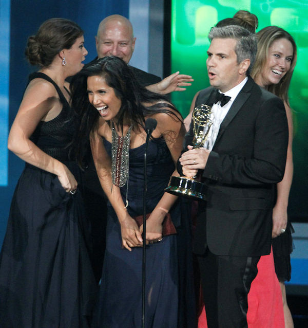 Padma Lakshmi, center,Tom Colicchio, rear, Gail Simmons, left, and show producers accept the award for outstanding reality competition program during the 62nd Primetime Emmy Awards Sunday, Aug. 29, 2010, in Los Angeles. (AP Photo/Chris Carlson)