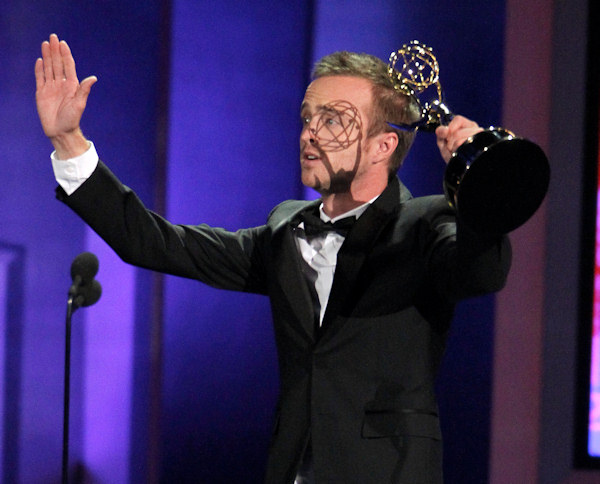 Aaron Paul accepts the award for outstanding supporting actor in a drama series during the 62nd Primetime Emmy Awards Sunday, Aug. 29, 2010, in Los Angeles. (AP Photo/Chris Carlson)