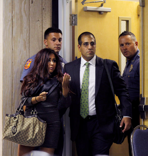 Nicole Polizzi, left, better known as Snooki from the MTV show &#34;Jersey Shore&#34; walks with her attorney Raymond A. Raya into in court Wednesday, Sept. 8, 2010, in Seaside Heights, N.J. Polizzi face charges of being a public nuisance and annoying others on the Seaside Heights beach in July.  <span class=meta>(AP Photo&#47;Mel Evans)</span>