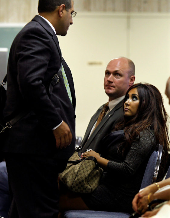 Nicole Polizzi, right, better known as Snooki from the MTV show &#34;Jersey Shore&#34; looks up to her attorney Raymond A. Raya, left, as she sits in court Wednesday, Sept. 8, 2010, in Seaside Heights, N.J. Polizzi face charges of being a public nuisance and annoying others on the Seaside Heights beach in July. <span class=meta>(AP Photo&#47;Mel Evans)</span>