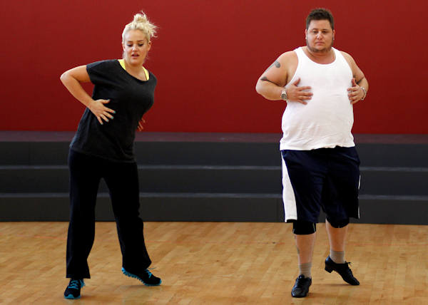 "Chaz Bono and Lacey Schwimmer rehearse for the upcoming season of ""Dancing of the Stars"" in Los Angeles, Wednesday, Sept. 7, 2011. The new season of ""Dancing with the Stars"" premieres Sept. 19 on ABC. (AP Photo/Matt Sayles)"
