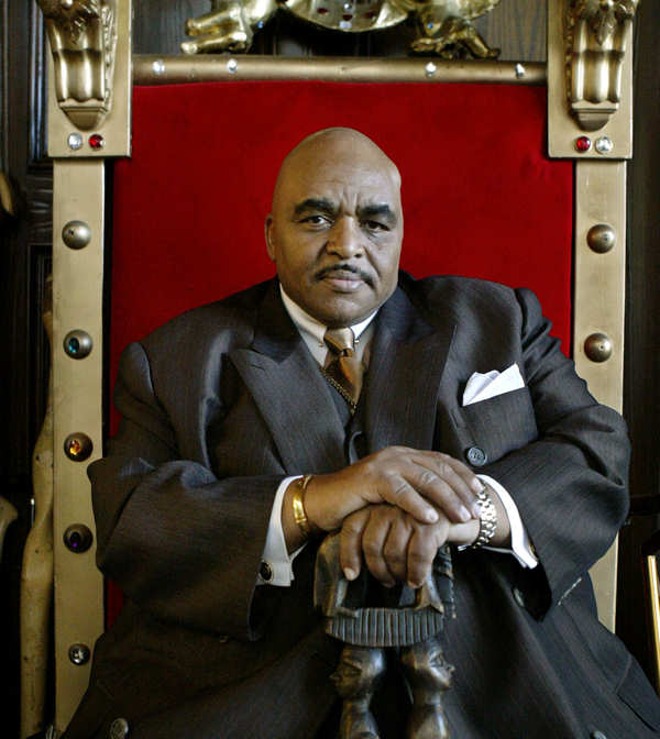 File - Solomon Burke, the king of rock and soul - a title that Burke  has embraced ever since a Baltimore disc jockey is said to have hung it on him in 1964 - poses in his red velvet throne in his Los Angeles home in this April 21, 2005 file photo. Burke has died at Amsterdam&#39;s Schiphol Airport. Airport police spokesman Robert van Kapel confirmed the death of the singer Sunday Oct. 10, 2010. He was 70.  <span class=meta>(AP Photo&#47;Ric Francis, File)</span>