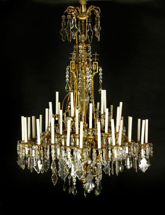 "19th Century French chandelier, with ormolu bronze leaf design and hand cut crystal prisms, attributed to Baccarat, recently electrified, 63"" h x 45"" dia. Property of Oprah Winfrey. EST: $20,000 - $40,000 More Information: http://www.kaminskiauctions.com/the-oprah-winfrey-collection/"