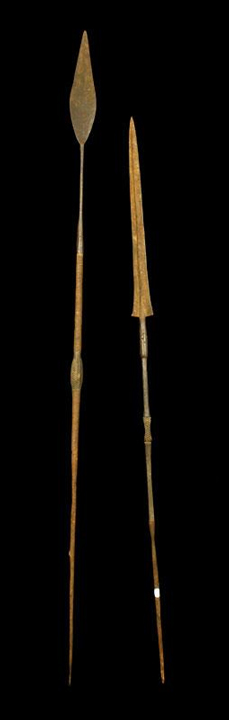 "Pair of Oceanic spears, with chipped carved handle detail, 75"" long. Property of Bob Greene. EST: $300 - $500 More Information: http://www.kaminskiauctions.com/the-oprah-winfrey-collection/"