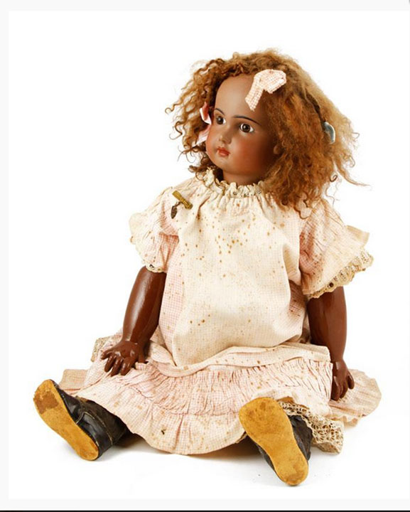 "Jumeau doll, marked ""Tete Jumeau,"" on back of neck, 27"" long. Property of Oprah Winfrey. EST: $5,000 - $8,000 More Information: http://www.kaminskiauctions.com/the-oprah-winfrey-collection/"