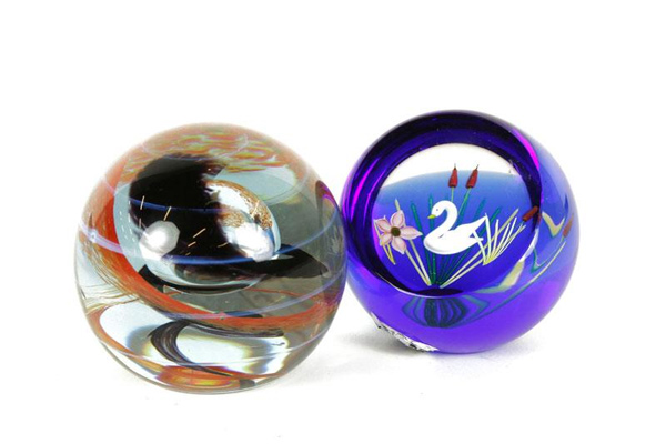 Two Caithness Swan Lake paperweights, with swirl pattern, Scotland. Property from various fine estates. EST: $300 - $500 More Information: http://www.kaminskiauctions.com/the-oprah-winfrey-collection/