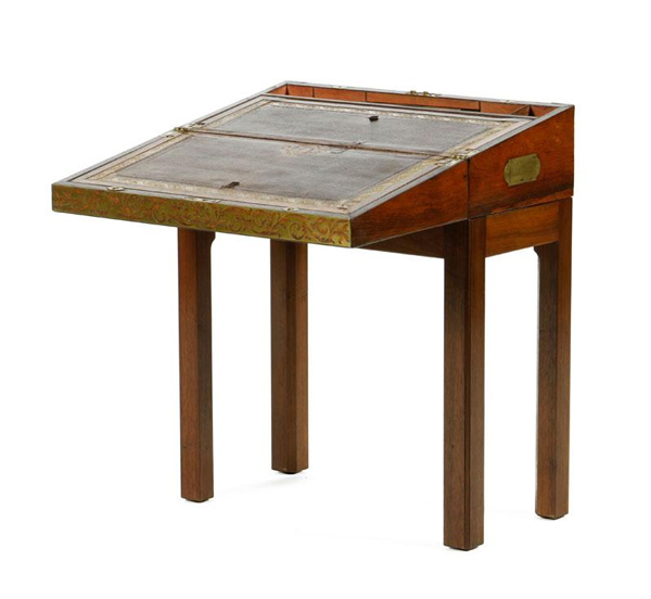 "Early 19th Century English sea captain's lap desk, on stand, rosewood, with brass inlay, writing surface with tooled leather top, 25"" h x 20"" w x 10"" d. Property of Oprah Winfrey. EST: $700 - $1,200 More Information: http://www.kaminskiauctions.com/the-oprah-winfrey-collection/"