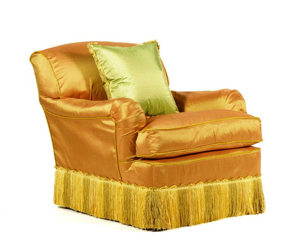 "George Smith LTD Occasional lounge chair, with custom made silk slip cover, and coordinating custom pillow, 32 1/2"" h x 30"" w x 38"" d. Property of Oprah Winfrey. EST: $700 - $1,200 More Information: http://www.kaminskiauctions.com/the-oprah-winfrey-collection/"