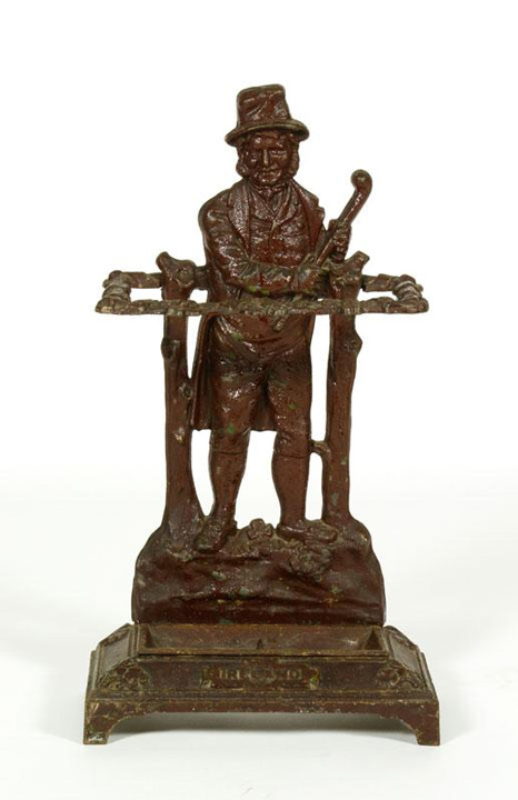 "19th Century umbrella stand, cast iron, with figural design, marked Ireland, 29"" h x 16"" w x 8"" d. Property of Oprah Winfrey. EST: $300 - $500 More Information: http://www.kaminskiauctions.com/the-oprah-winfrey-collection/"
