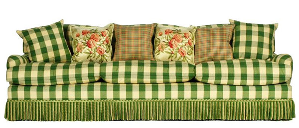 "George Smith Standard Arm sofa, in green plaid upholstery, with green and cream rope edge detail and matching fringe, along with six pillows, including two in matching fabric, two in multicolor plaid fabric, and two floral patterned pillows, with label, made in Newcastle, England, 33"" h x 105"" w x 39"" d. Property of Oprah Winfrey. EST: $3,000 - $4,000 More Information: http://www.kaminskiauctions.com/the-oprah-winfrey-collection/"