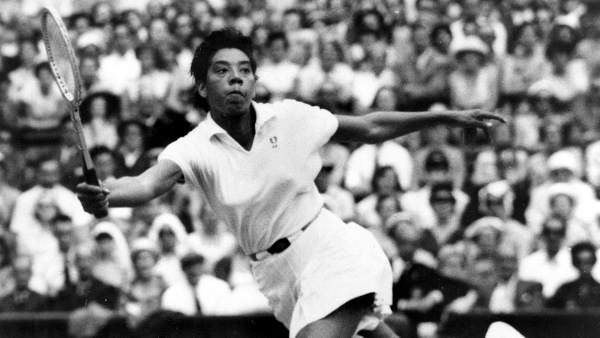 """<div class=""""meta image-caption""""><div class=""""origin-logo origin-image """"><span></span></div><span class=""""caption-text"""">Born August 25, 1927 in Silver, SC, Althea Gibson grew up in Harlem. A trailblazing athlete, Gibson is often referred to as ?Jackie Robinson of tennis.? She won 56 singles and doubles titles during her amateur career in the 1950s before gaining international and national acclaim as a pro. Gibson won 11 major titles in the late 1950s, including singles titles at the French Open, Wimbledon and the U. S. Open, as well as three straight doubles crowns at the French Open. In 1957, she was the first black to be voted by the Associated Press as its Female Athlete of the Year. She won the honor again in 1958. She became New Jersey State Commissioner of Athletics in 1975, a post she held for 10 years. She then served on the State's Athletics Control Board until 1988 and the Governor's Council on Physical Fitness until 1992. Gibson died at East Orange General Hospital in 2003 at the age of 76.  (Photo/AP Photo)</span></div>"""