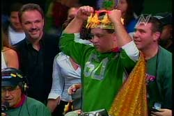 The Wing King gets the royal treatment after consuming 154 wings- a new WingBowl record