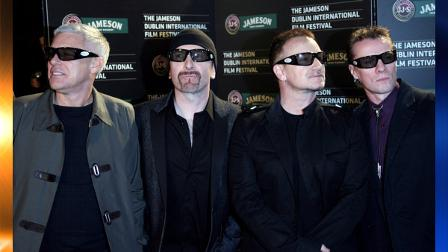 ** FILE ** In this Feb. 20, 2008 file photo, U2 band members, from left, Adam Clayton, The Edge, Bono and Larry Mullen attend the Dublin International Film Festival for the European premiere of their concert film U2 3D, Dublin, Ireland. (AP Photo/Peter Morrison, file)