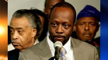 Haitian musician and humanitarian Wyclef Jean, center, is joined by clergy including the Rev. Al Sharpton, left, and the Rev. Herbert Daughtry, right, during a news conference pledging their support to Yele, the humanitarian and relief organization headed by Jean in New York, Wednesday Jan. 27, 2010.