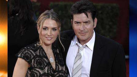 FILE - In this Sept. 20, 2009, file photo, actor Charlie Sheen, right, and his wife Brooke Mueller arrive at the 61st Primetime Emmy Awards in Los Angeles. (AP Photo/Chris Pizzello, file)