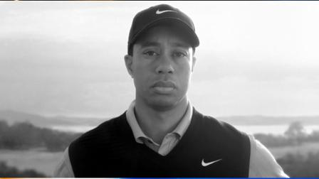 In this image provided by Nike Inc., Tiger Woods appears in a Nike commercial to air starting Wednesday, April 7, 2010 on ESPN. In the stark, black-and-white ad, Woods looks directly into the camera without speaking while a recording of his late father is heard, speaking about taking responsibility. (AP Photo/Nike)