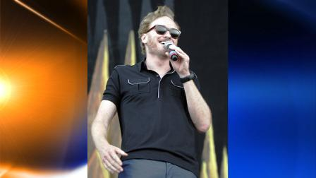 Comedian Conan OBrien appears on stage at the Bonnaroo Music and Arts Festival in Manchester, Tenn. Friday, June 11, 2010. (AP Photo/Jeff Christensen)