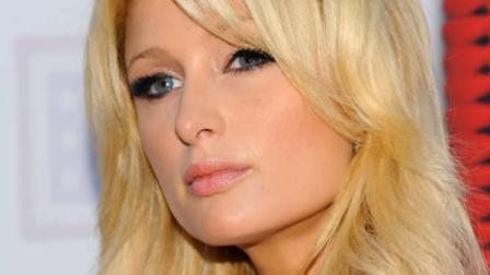 Television personality Paris Hilton arrives at the USOs Songs For Soldiers initiative event on Wednesday, May 26, 2010 in New York. (AP Photo/Evan Agostini)