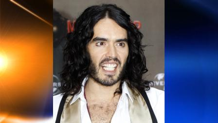 FILE - In this June 25, 2010 file photo, British actor Russell Brand poses during a photo-call to promote his movie Get Him To The Greek in Berlin. (AP Photo/Markus Schreiber, file)