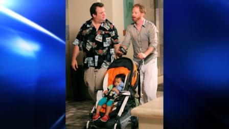 In this publicity image released by ABC, Eric Stonestreet, left and Jesse Tyler Ferguson are shown in a scene from Modern Family. (AP Photo/ABC, Mario Perez)