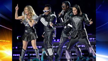 The Black Eyed Peas featuring Fergie, left, apl.de.ap., will.i.am, and Taboo, right, and apl.de.ap perform during halftime of NFL football Super Bowl XLV Sunday, Feb. 6, 2011, in Arlington, Texas. (AP Photo/Dave Martin)