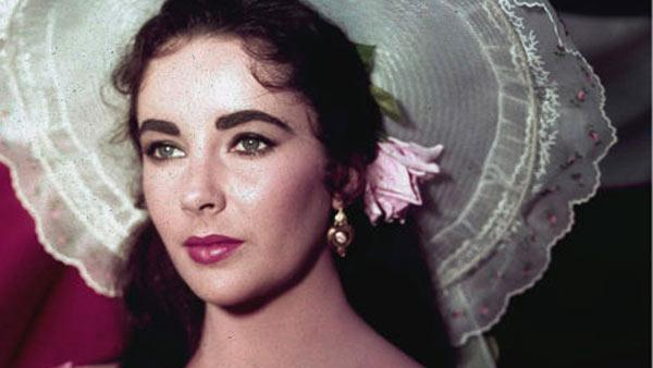 Actress Elizabeth Taylor is shown in costume for her character in the 1957 film 'Raintree County.'