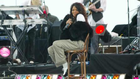 Janet Jackson sits in a chair on stage in New Yorks Battery Park after perfoming a live television concert on ABCs Good Morning America, Wednesday, March 31, 2004. This was Jacksons first television performance since her controversial Super Bowl appearance earlier this year.