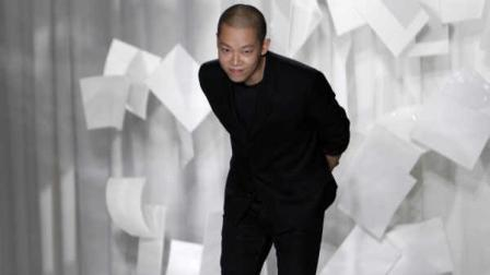Designer Jason Wu takes a bow after presenting his Spring 2012 collection Friday, Sept. 9, 2011, during Fashion Week in New York. (AP Photo/Mary Altaffer)