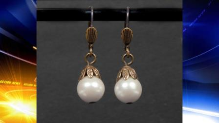 This undated photo provided by Juliens Auctions shows a pearl drop earrings worn by Whitney Houston in The Bodyguard and which sold for $2,812 at an auction in Beverly Hills of memorabilia from the late pop stars career on Saturday, March 31, 2012, in Beverly Hills, Calif. (AP Photo/Juliens Auctions)