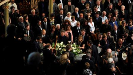 The casket of Earl Scruggs passes an honor guard of banjo players during the funeral service for the banjo great and bluegrass pioneer at the Ryman Auditorium on Sunday, April 1, 2012, in Nashville, Tenn. Scruggs died Wednesday, March 28, 2012. He was 88. (AP Photo/Joe Howell, Pool)