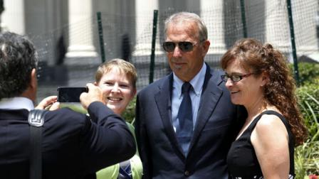 Actor Kevin Costner poses for photos with Krista Armstrong, right, and Kasey Cummings, as he leaves Federal Court for a lunch break in New Orleans, Monday, June 4, 2012. Stephen Baldwin has sued Costner over their investments in a device that BP used in trying to clean up the massive Gulf of Mexico oil spill. The federal lawsuit filed in New Orleans by Baldwin and a friend claims Costner and a business partner duped them out of their shares of an $18 million deal for BP to purchase oil-separating centrifuges from a company they formed after the April 20 spill. ( AP Photo/Bill Haber)