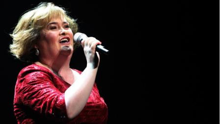 Susan Boyle performs during her musical I Dreamed A Dream at the Theatre Royal in Newcastle, England, Tuesday, March 27, 2012. (AP Photo/Scott Heppell)