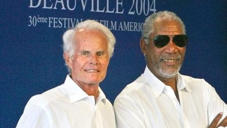 Producer Richard D. Zanuck, left, and actor Morgan Freeman pose during a photocall at the 30th American Film Festival of Deauville, Normandy, Tuesday, Sept. 7, 2004. The festival will pay a tribute to Zanuck Tuesday evening. (AP Photo/Franck Prevel)