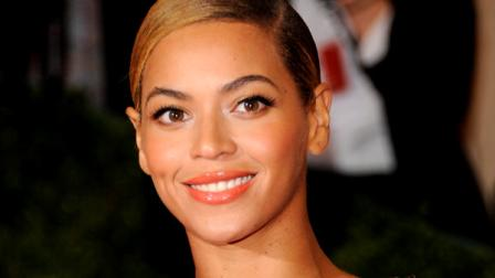 FILE - This May 7, 2012 file photo shows Beyonce Knowles at the Metropolitan Museum of Art Costume Institute gala benefit, celebrating Elsa Schiaparelli and Miuccia Prada in New York. Beyonce is teaming with the United Nations and humanitarian aid organizations on a global campaign to encourage people around the world to get involved. The international pop star and songwriter Diane Warren will donate a video of I Was Here that will be filmed in the UN General Assembly Hall in New York in front of a live audience. The video will premiere Aug. 19 on World Humanitarian Day and the UN hopes it will help the campaign reach 1 billion people. (AP Photo/Evan Agostini, file)