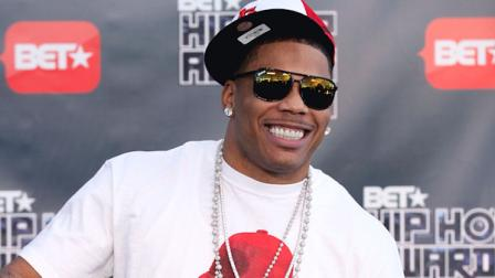 FILE - This Oct. 1, 2011 file photo shows rapper Nelly arriving for the BET Hip Hop Awards in Atlanta. Authorities say they found drugs and a gun on rapper Nellys tour bus at a West Texas border checkpoint where several celebrities have been arrested. Hudspeth County sheriffs officials said an initial search Wednesday, Oct. 10, 2012, turned up small amounts of marijuana and heroin and a loaded gun. Authorities say a second search revealed a duffel bag with about 10 pounds of pot. (AP Photo/David Goldman, file)