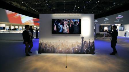 Technicians install Sonys 4k Ultra HD television at the Sony booth at the International Consumer Electronics Show in Las Vegas, Monday, Jan. 7, 2013. The 2013 International CES gadget show, the biggest trade show in the Americas, is taking place in Las Vegas this week. (AP Photo/Jae C. Hong)