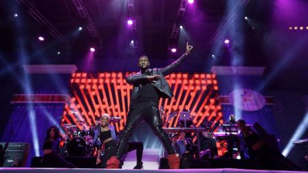 Usher performs during the Kids Inaugural: Our Children. Our Future. event in Washington, Saturday, Jan. 19, 2013. (AP Photo/Gerald Herbert)