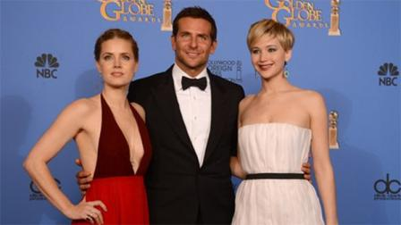 From left, Amy Adams, Bradley Cooper, and Jennifer Lawrence, winners of the award for best motion picture - comedy or musical for American Hustle pose in the press room at the 71st annual Golden Globe Awards at the Beverly Hilton Hotel on Sunday, Jan. 12, 2014, in Beverly Hills, Calif. (Photo by Jordan Strauss/Invision/AP)