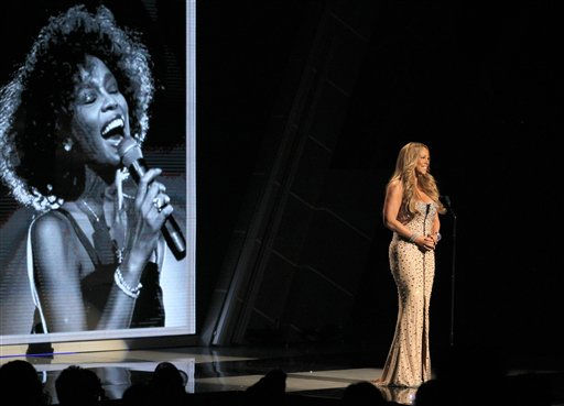 Mariah Carey speaks during the in memoriam to Whitney Houston at the BET Awards on Sunday, July 1, 2012, in Los Angeles. <span class=meta>(AP Photo)</span>
