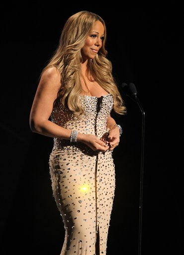 Mariah Carey speaks during the in memoriam to Whitney Houston at the BET Awards on Sunday, July 1, 2012, in Los Angeles <span class=meta>(AP Photo)</span>