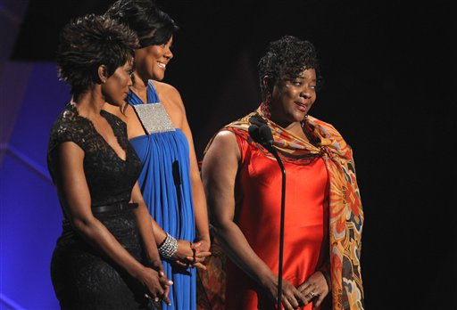 "<div class=""meta image-caption""><div class=""origin-logo origin-image ""><span></span></div><span class=""caption-text"">From left, Angela Bassett, Lela Rochon, and Loretta Devine speak during the in memoriam for Whitney Houston at the BET Awards on Sunday, July 1, 2012, in Los Angeles (AP photo)</span></div>"