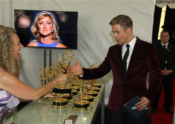 Exclusive - Derek Hough, winner of the award for outstanding choreography for his work on &#34;Dancing with the Stars,&#34; is seen at the trophy table at the 65th Primetime Emmy Awards at Nokia Theatre on Sunday Sept. 22, 2013, in Los Angeles.   <span class=meta>(Phot by Matt Sayles&#47;Invision for Academy of Television Arts &amp; Sciences&#47;AP Images)</span>