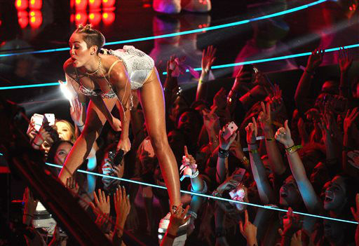 "<div class=""meta ""><span class=""caption-text "">Miley Cyrus performs at the MTV Video Music Awards on Sunday, Aug. 25, 2013, at the Barclays Center in the Brooklyn borough of New York. (Photo by Charles Sykes/Invision/AP) (Photo/Charles Sykes)</span></div>"