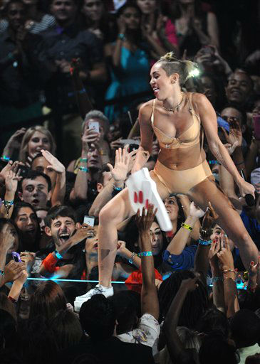 "<div class=""meta image-caption""><div class=""origin-logo origin-image ""><span></span></div><span class=""caption-text"">Miley Cyrus performs at the MTV Video Music Awards on Sunday, Aug. 25, 2013, at the Barclays Center in the Brooklyn borough of New York. (Photo by Charles Sykes/Invision/AP)</span></div>"