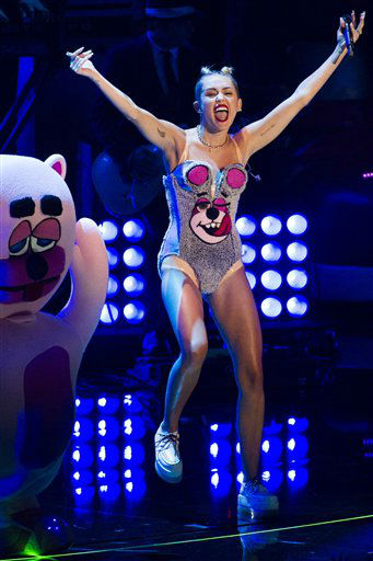 "<div class=""meta image-caption""><div class=""origin-logo origin-image ""><span></span></div><span class=""caption-text"">Miley Cyrus performs at the MTV Video Music Awards on Sunday, Aug. 25, 2013, at the Barclays Center in the Brooklyn borough of New York. (Photo by Charles Sykes/Invision/AP)  (Photo/Charles Sykes)</span></div>"